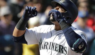 Seattle Mariners' Nelson Cruz looks up as he crosses the plate after hitting a two-run home run against the Cleveland Indians during the sixth inning of a baseball game, Saturday, March 31, 2018, in Seattle. (AP Photo/Ted S. Warren)
