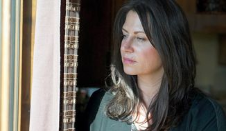 """In this undated file photo provided by the Southern Poverty Law Center, Tanya Gersh poses for a photo. A neo-Nazi website publisher's travels outside the U.S. don't warrant dismissal of a lawsuit over an anti-Semitic online trolling campaign he orchestrated against a Montana family, a federal magistrate judge said in an order Wednesday, March 21, 2018. U.S. Magistrate Judge Jeremiah Lynch said there is sufficient evidence that The Daily Stormer's publisher, Andrew Anglin, was legally """"domiciled"""" in Ohio when Montana real estate agent Gersh sued him last April. (Dan Chung/Southern Poverty Law Center via AP, File) **FILE**"""