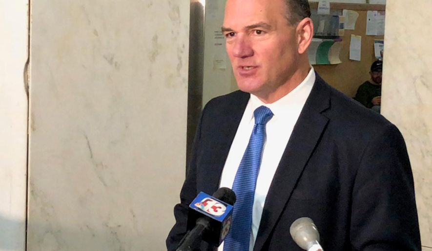 A state court judge will rule soon on the fate of former Cedar Rapids Mayor Ron Corbett's campaign for governor. Corbett asked a Polk County judge Tuesday, April 3, 2018, to allow signatures crossed out in his ballot petition to be counted after a state elections panel refused to consider them.  Corbett is seeking to challenge Gov. Kim Reynolds in the Republican primary. (AP Photo/Scott Stewart)