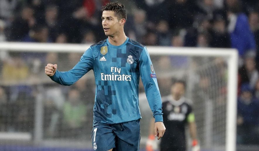 Real Madrid's Cristiano Ronaldo celebrates after scoring the second goal of his team during the Champions League, round of 8, first-leg soccer match between Juventus and Real Madrid at the Allianz stadium in Turin, Italy, Tuesday, April 3, 2018. (AP Photo/Luca Bruno)