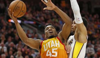 Utah Jazz guard Donovan Mitchell (45) goes to the basket as Los Angeles Lakers guard Josh Hart, right, defends during the second half of an NBA basketball game Tuesday, April 3, 2018, in Salt Lake City. (AP Photo/Rick Bowmer)