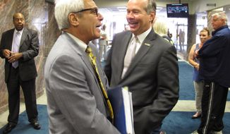 Commissioner of Higher Education Joseph Rallo, left, talks with LSU President F. King Alexander ahead of a House budget hearing on public college financing, on Tuesday, April 3, 2018, in Baton Rouge, La. (AP Photo/Melinda Deslatte)