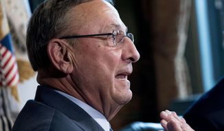 FILE - In this Sept. 22, 2017 file photo, Maine Gov. Paul LePage speaks to members of the media before a meeting to discuss health care and tax reform in the Eisenhower Executive Office Building on the White House Complex in Washington. A federal appeals court is set to hear arguments Tuesday, April 3, 2018 in Boston in a lawsuit filed by Maine Democratic House Speaker Mark Eves accusing Republican Maine Gov. Paul LePage of abuse of power and blackmail. (AP Photo/Andrew Harnik, File)