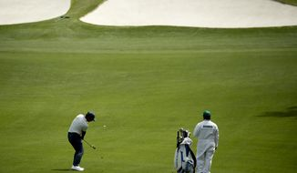 Shubhankar Sharma, of India, hits from the fairway on the seventh hole during practice for the Masters golf tournament at Augusta National Golf Club, Monday, April 2, 2018, in Augusta, Ga. (AP Photo/Charlie Riedel)