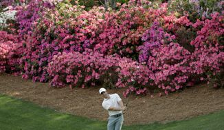 Rory McIlroy, of Northern Ireland, hits a chip on the 13th hole during practice for the Masters golf tournament at Augusta National Golf Club, Tuesday, April 3, 2018, in Augusta, Ga. (AP Photo/Matt Slocum)