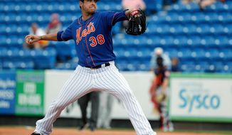 FILE - In this Feb. 27, 2018, file photo, New York Mets pitcher Anthony Swarzak throws during the third inning of a spring training baseball game against the Houston Astros in Port St. Lucie, Fla. Swarzak was placed Tuesday, April 3, on the 10-day DL after straining a muscle on his left side in his second appearance with New York. The team recalled right-hander Hansel Robles from Triple-A Las Vegas before Tuesday night's game against Philadelphia. (AP Photo/Jeff Roberson, File)