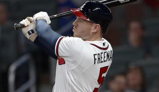 Atlanta Braves' Freddie Freeman (5) follows through on a three-run home run in the second inning of a baseball game against the Washington Nationals on Tuesday, April 3, 2018, in Atlanta. (AP Photo/John Bazemore)