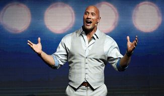 """FILE - This March 28, 2017, file photo, Dwayne Johnson, a cast member in the upcoming film """"Baywatch,"""" addresses the audience during the Paramount Pictures presentation at CinemaCon 2017 in Las Vegas. Johnson said """"depression never discriminates."""" The actor talks about his struggles with depression and his mother's suicide attempt after they were evicted in an interview with the Sunday Express. (Photo by Chris Pizzello/Invision/AP, File)"""