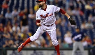 FILE - In this July 21, 2017, file photo, Philadelphia Phillies' Pat Neshek watches a pitch during the team's baseball game against the Milwaukee Brewers in Philadelphia. As an early April snowstorm hit New York City on Monday morning, Neshek found a fun way to pass the time. Opening packs of baseball cards, the avid collector unwrapped a rare gem, an autographed Shohei Ohtani rookie card from the 2018 Topps Heritage set. (AP Photo/Derik Hamilton, File)