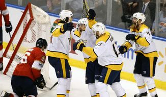 Nashville Predators players including Nashville Predators left wing Viktor Arvidsson, third from left, celebrate what appeared to be a goal in the final seconds of play against the Florida Panthers in an NHL hockey game, Tuesday, April 3, 2018, in Sunrise, Fla. The goal, which would have tied the game, was disallowed. The Panthers won the game 2-1. (AP Photo/Joe Skipper)
