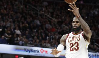 Cleveland Cavaliers' LeBron James (23) passes the ball over Toronto Raptors' Serge Ibaka (9) during the first half of an NBA basketball game Tuesday, April 3, 2018, in Cleveland. (AP Photo/Tony Dejak) **FILE**