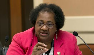 """In this Aug. 23, 2017, file photo, Assemblywoman Shirley Weber, D-San Diego, questions representatives of the California State University system about a recent audit of spending on management staff, during a joint legislative hearing in Sacramento, Calif. Several state lawmakers and the family of a 22-year-old unarmed black man fatally shot by police want to make California the first to significantly restrict when officers can open fire. Democratic Assembly members Weber and Kevin McCarty plan to propose a bill Tuesday, April 3, 2018, that would change the current """"reasonable force"""" rule to """"necessary force."""" (AP Photo/Rich Pedroncelli, File)"""