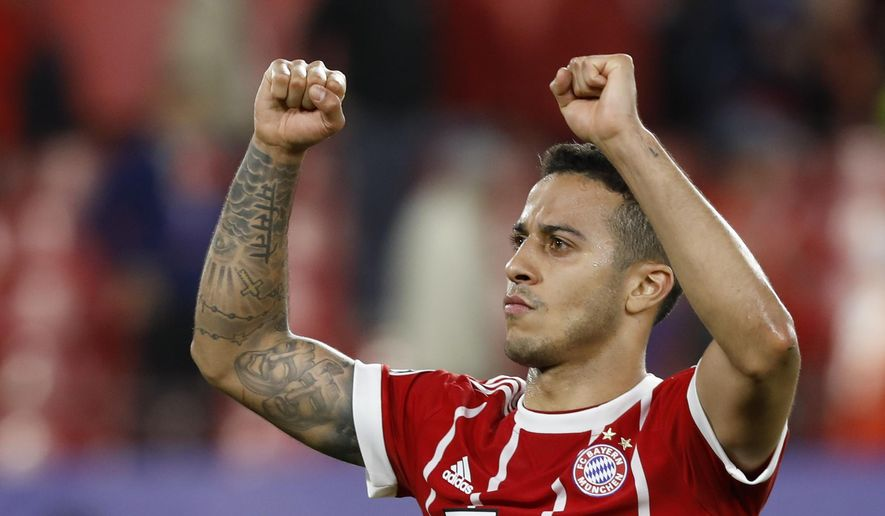 Bayern's Thiago celebrates after the Champions League quarter final first leg soccer match between Sevilla FC and FC Bayern Munich at the Sanchez Pizjuan stadium in Seville, Spain, Tuesday, April 3, 2018. (AP Photo/Miguel Morenatti)