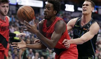 Portland Trail Blazers forward Al-Farouq Aminu (8) attempts to gain control of a defensive rebound in front of Dallas Mavericks' Dwight Powell, right, in the first half of an NBA basketball game in Dallas, Tuesday, April 3, 2018. (AP Photo/Tony Gutierrez)