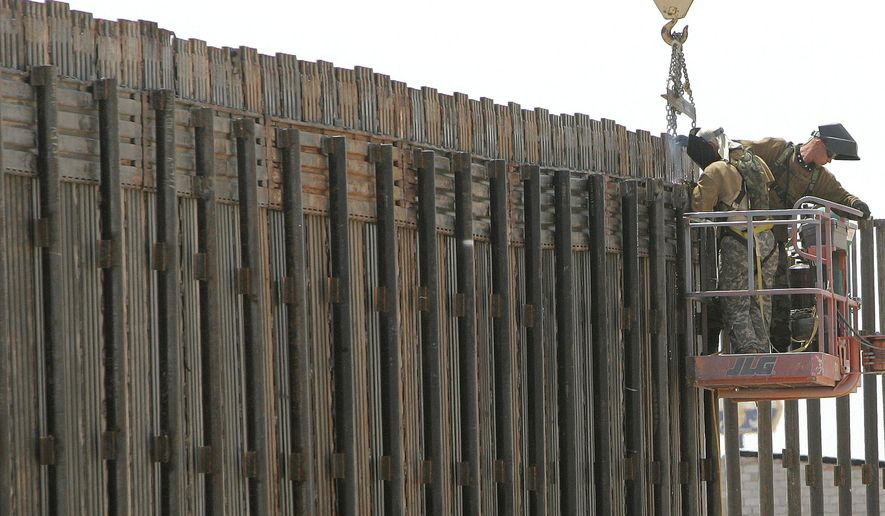 In this June 13, 2006, file photo, Utah National Guard soldiers work on extending a border fence in San Luis, Ariz., President Donald Trump said April 3, 2018, he wants to use the military to secure the U.S.-Mexico border until his promised border wall is built. The Department of Homeland Security and White House did not immediately respond to requests for comment. At the Pentagon, officials were struggling to answer questions about the plan, including rudimentary details on whether it would involve National Guard members, as similar programs in the past have done. But officials appeared to be considering a model similar to a 2006 operation in which former President George W. Bush deployed National Guard troops to the southern border in an effort to increase security and surveillance. (AP Photo/Khampha Bouaphanh)