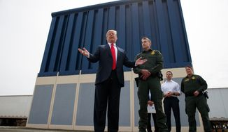 FILE--In this March 13, 2018, file photo, President Donald Trump talks with reporters as he reviews border wall prototypes in San Diego. In his threat Tuesday, April 3, 2018, to use the military on the U.S.-Mexico border until his promised wall is built, Trump again heaped blame on his predecessor, Barack Obama, and congressional Democrats for creating a dangerous and dysfunctional border. (AP Photo/Evan Vucci, file)