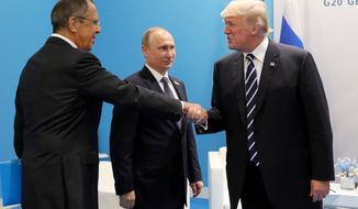 FILE - In this July 7, 2017, file photo, President Donald Trump, right, greets Russian Foreign Minister Sergey Lavrov, left, prior his talks with Russian President Vladimir Putin, center, during the G20 summit in Hamburg Germany. The Trump administration is opening the door to a potential White House meeting between Trump and Putin. It would be the first time Putin has been at the White House in more than a decade and come at a time of rising tensions between the two global powers.  (Mikhail Klimentyev, Kremlin Pool Photo via AP)