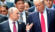 U.S. President Donald Trump (right) and Russia President Vladimir Putin talk during the family photo session at the APEC Summit in Danang on Nov. 11, 2017. (Mikhail Klimentyev, Sputnik, Kremlin Pool Photo via AP) **FILE**