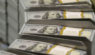 In this Sept. 24, 2013, file photo, cut stacks of $100 bills make their way down the line at the Bureau of Engraving and Printing Western Currency Facility in Fort Worth, Texas. (AP Photo/LM Otero) ** FILE **
