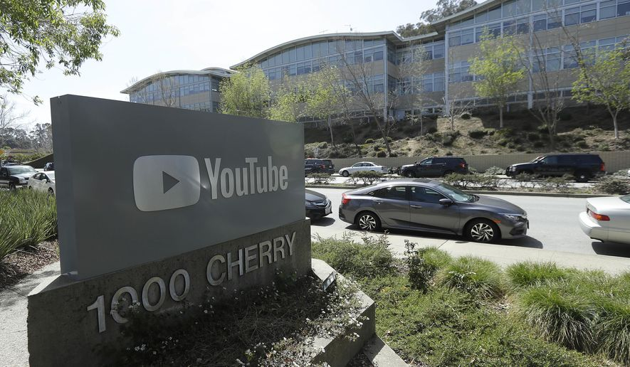 A YouTube sign is shown across the street from the company's offices in San Bruno, Calif., Tuesday, April 3, 2018. A woman opened fire at YouTube headquarters Tuesday, setting off a panic among employees and wounding at least four people before fatally shooting herself, police and witnesses said. (AP Photo/Jeff Chiu)