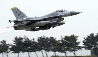 """U.S. Air Force's F-16 fighter takes off during an annual joint air exercise """"Max Thunder"""" between South Korea and the U.S. at a U.S. air base in Gunsan, South Korea, Thursday, April 20, 2017. (Go Bum-jun/Newsis via AP) ** FILE **"""