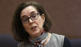 """If @realDonaldTrump asks me to deploy Oregon Guard troops to the Mexico border, I'll say no. As Commander of Oregon's Guard, I'm deeply troubled by Trump's plan to militarize our border,"" Oregon Gov. Kate Brown wrote on Twitter. (Associated Press)"