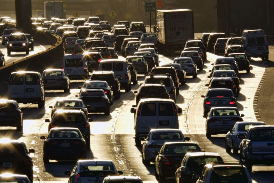 FILE - In this Nov. 15, 2016 file photo, morning rush hour traffic makes its way along US 101 near downtown Los Angeles. Car insurance for immigrants who lack legal papers has been tough to get, but a growing number of states now issue drivers licenses despite immigration status. (AP Photo/Richard Vogel, File)
