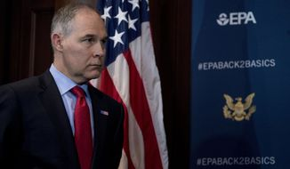 Environmental Protection Agency Administrator Scott Pruitt attends a news conference at the Environmental Protection Agency in Washington, Tuesday, April 3, 2018, on his decision to scrap Obama administration fuel standards. (AP Photo/Andrew Harnik)