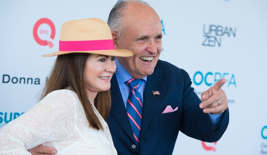 """Judith Giuliani, left, and Rudy Giuliani attend the Ovarian Cancer Research Fund Alliance's (OCRFA) 19th annual """"Super Saturday"""" garage sale benefit at Nova's Ark Project in Water Mill on Saturday, July 30, 2016, in New York. (Photo by Scott Roth/Invision/AP)"""