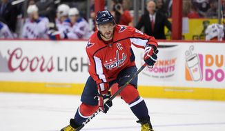 Washington Capitals left wing Alex Ovechkin (8), of Russia, skates with the puck during the second period of an NHL hockey game against the New York Rangers, Wednesday, March 28, 2018, in Washington. (AP Photo/Nick Wass)