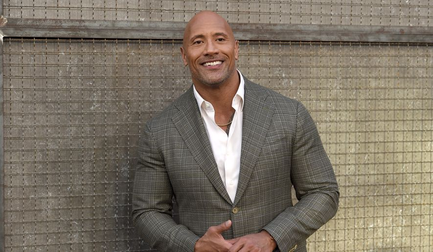 """Dwayne Johnson arrives at the world premiere of """"Rampage"""" at the Microsoft Theater on Wednesday, April 4, 2018, in Los Angeles. (Photo by Chris Pizzello/Invision/AP)"""