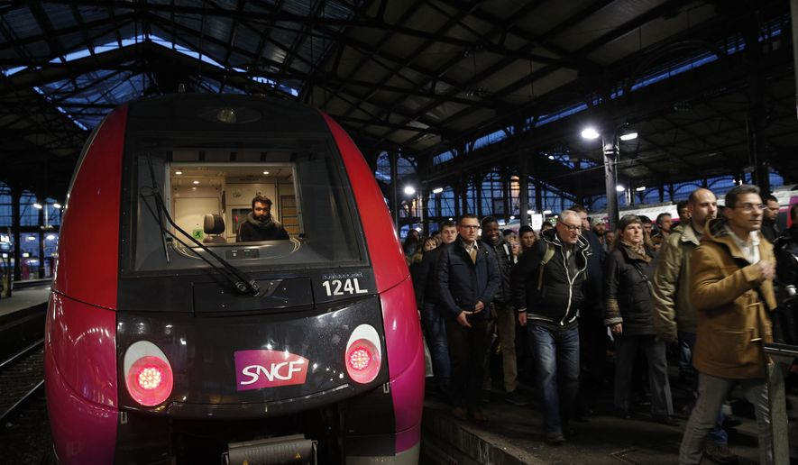 Commuters arrive at Saint-Lazare train station in Paris, Wednesday, April 4, 2018 in the first of a series of strikes that are set to last three months. A major French railway strike has brought the country's famed high-speed trains to a halt, leaving passengers stranded and posing the biggest test so far for President Emmanuel Macron's economic strategy. (AP Photo/Christophe Ena)