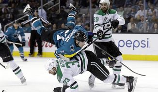 San Jose Sharks' Joonas Donskoi, top center, collides with Dallas Stars' Marc Methot, bottom center, as Stars' Greg Pateryn closes in during the second period of an NHL hockey game Tuesday, April 3, 2018, in San Jose, Calif. (AP Photo/Marcio Jose Sanchez)