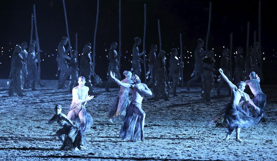 Aboriginal dancers perform at Carrara Stadium for the opening ceremony of the 2018 Commonwealth Games on the Gold Coast, Australia, Wednesday, April 4, 2018. (AP Photo/Manish Swarup)