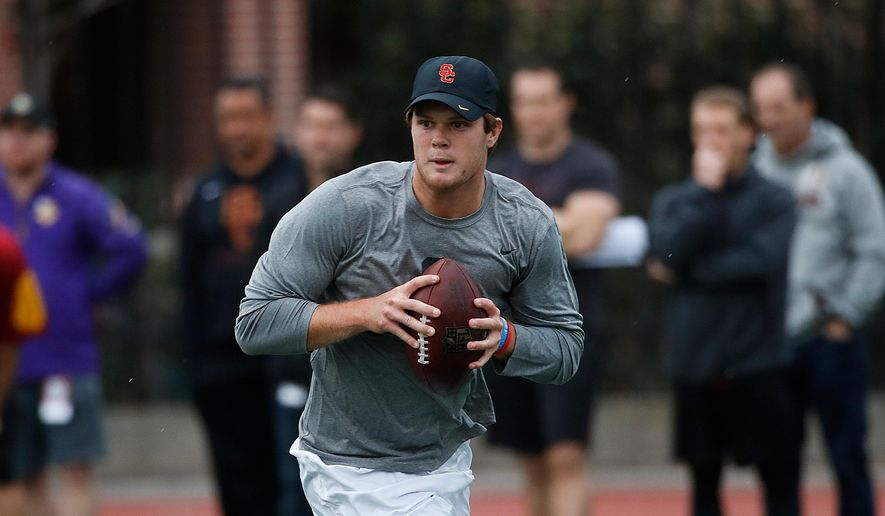 FILE - In this March 21, 2018, file photo, Southern California quarterback Sam Darnold looks to throw a pass during USC Pro Day in Los Angeles. Darnold is visiting the Cleveland Browns, Wednesday, April 4, 2018, who are spending the week meeting with quarterbacks to potentially draft No. 1 overall. (AP Photo/Jae C. Hong, File)