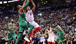 Toronto Raptors guard DeMar DeRozan (10) is defended by Boston Celtics centre Greg Monroe, left, as Celtics forward Marcus Morris (13), Raptors guard Kyle Lowry (7) and Celtics guard Kadeem Allen watch during the second half of an NBA basketball game Wednesday, April 4, 2018, in Toronto. (Frank Gunn/The Canadian Press via AP)
