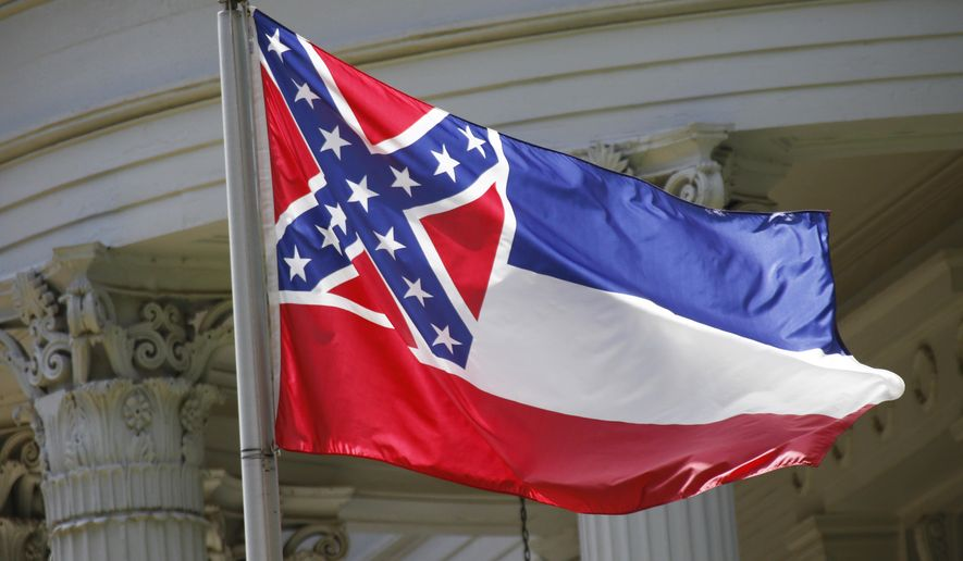 """This June 23, 2015 file photo, shows the state flag of Mississippi at the Governor's Mansion in Jackson, Miss. A federal lawsuit filed Wednesday, April 4, 2018, says the Mississippi flag is """"racially demeaning and hostile"""" because it contains the Confederate battle emblem. Several Mississippi cities and counties, and all eight public universities, have stopped flying the flag in recent years amid criticism that the Confederate emblem is a racist reminder of slavery and segregation. (AP Photo/Rogelio V. Solis, File)"""
