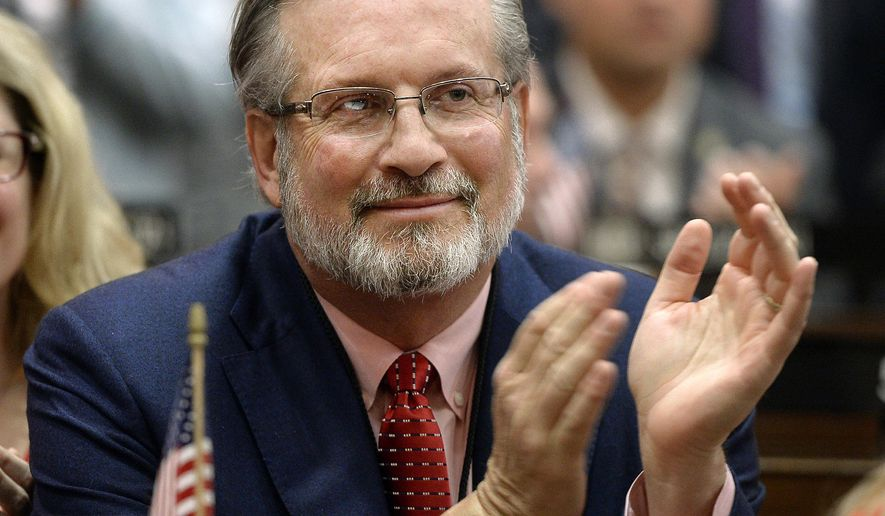 FILE - In this Jan. 4, 2017, file photo, Connecticut State Rep. Dr. William Petit, R-Plainville, smiles during opening session at the state Capitol in Hartford, Conn. Petit, the survivor of a 2007 home invasion in which his wife and daughters were killed, is considering a run for the seat held by U.S. Rep. Elizabeth Esty, who announced Monday, April 2, 2018, she would not seek re-election. (AP Photo/Jessica Hill, File)