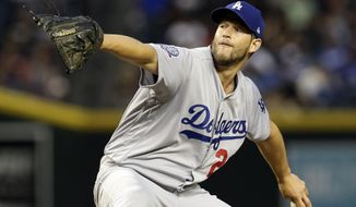 Los Angeles Dodgers starting pitcher Clayton Kershaw throws in the first inning during a baseball game against the Arizona Diamondbacks, Tuesday, April 3, 2018, in Phoenix. (AP Photo/Rick Scuteri)
