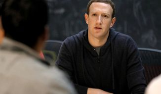 In this Nov. 9, 2017, file photo, Facebook CEO Mark Zuckerberg meets with a group of entrepreneurs and innovators during a round-table discussion in St. Louis. (AP Photo/Jeff Roberson, File)