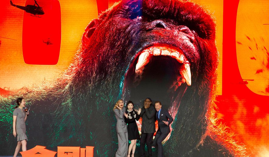 """FILE - In this March 16, 2017 file photo, the cast of movie """"Kong:Skull Island"""" from left, Brie Larson, Jing Tian, Samuel L. Jackson and Tom Hiddleston pose for a photo during a press conference in Beijing, China. Propelled by growth in China, global moviegoing reached a record high of $40.6 billion in 2017 despite a downturn in audiences at U.S. and Canada theaters. Much of the global increase was thanks to China, which accounted for $7.9 billion in ticket sales. (AP Photo/Ng Han Guan, File)"""