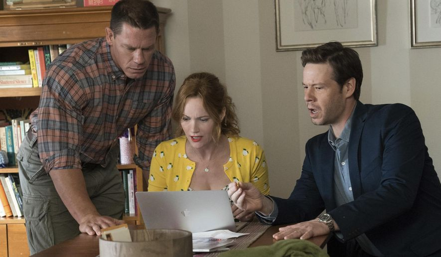 """This image released by Universal Pictures shows John Cena, from left, Leslie Mann and Ike Barinholtz in a scene from """"Blockers."""" (Quantrell D. Colbert/Universal Pictures via AP)"""