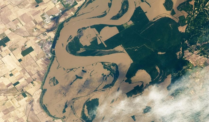 This May 12, 2011, photo released by NASA, and taken from the International Space Station, shows the Mississippi River spilling over its banks in Arkansas and Tennessee as the International Space Station passed overhead. This astronaut photograph shows muddy water sitting on floodplains around Tomato, Arkansas. Flood control work along the Mississippi River and its tributaries has likely made floods worse in Mississippi and Louisiana, according to a study reported in journal Nature, published Wednesday, April 4, 2018. Some other scientists are not convinced. (NASA via AP)