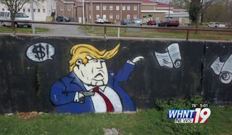 City workers in historic downtown Florence, Alabama, were tasked with cleaning up graffiti Tuesday after someone painted a mural of President Trump shooting schoolchildren. (WHNT)