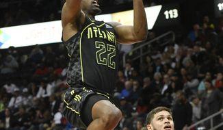 Atlanta Hawks guard Isaiah Taylor (22) shoots as Miami Heat guard Tyler Johnson watches during the first half of an NBA basketball game Wednesday, April 4, 2018, in Atlanta. (AP Photo/John Amis)