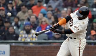 San Francisco Giants' Pablo Sandoval hits a three-run home run against the Seattle Mariners during the fifth inning of a baseball game Wednesday, April 4, 2018, in San Francisco. (AP Photo/Marcio Jose Sanchez)
