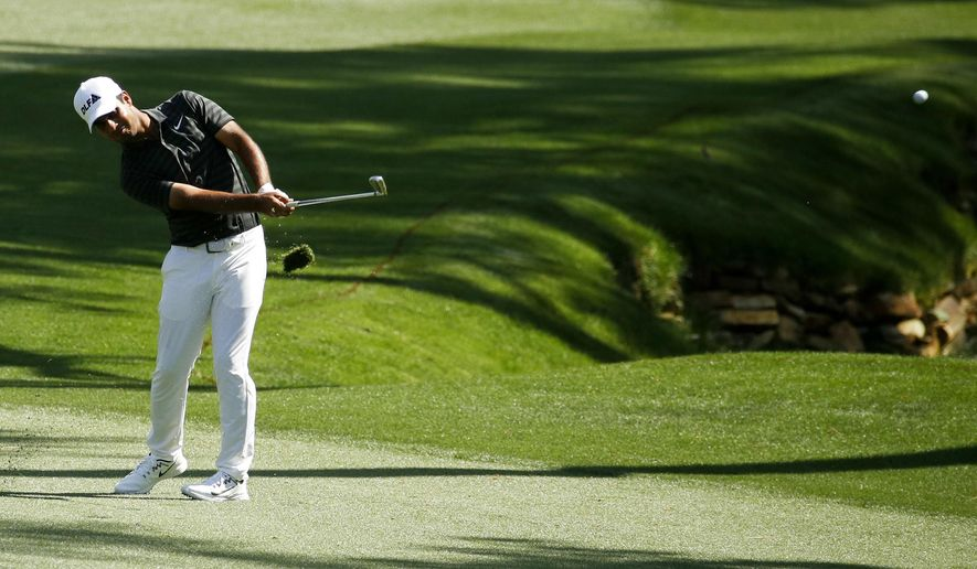 Shubhankar Sharma, of India, hits a chip on the 13th hole during practice for the Masters golf tournament at Augusta National Golf Club, Tuesday, April 3, 2018, in Augusta, Ga. (AP Photo/Charlie Riedel)
