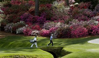 Rickie Fowler walks to the 13th green during practice for the Masters golf tournament at Augusta National Golf Club, Tuesday, April 3, 2018, in Augusta, Ga. (AP Photo/Charlie Riedel)