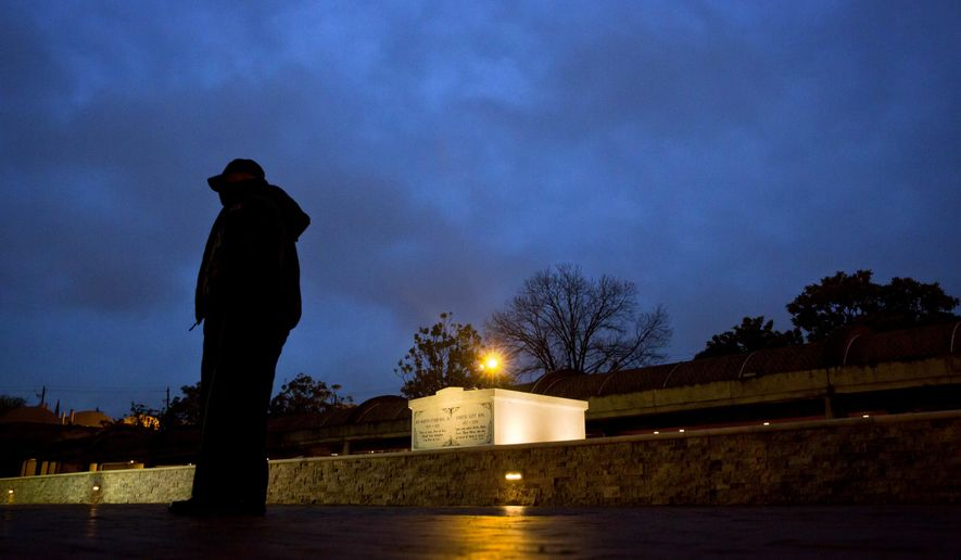 A security guards stands by the grave of the Rev. Martin Luther King Jr., on the 50th anniversary of his assassination in Atlanta, Wednesday, April 4, 2018. (AP Photo/David Goldman)