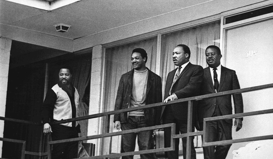 FILE - In this April 3, 1968 file photo, the Rev. Martin Luther King Jr. stands with other civil rights leaders on the balcony of the Lorraine Motel in Memphis, Tenn., a day before he was assassinated at approximately the same place. From left are Hosea Williams, Jesse Jackson, King, and Ralph Abernathy. (AP Photo/Charles Kelly, File)